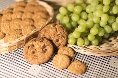 Food Image Green Grapes, Cookies, Tablecloth 2019 royalty free stock photography