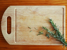 Food image :Rosemary on the cutting board Royalty Free Stock Photo