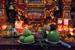 Food and incense stick offering in a temple Royalty Free Stock Photos