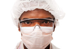 Food Industry Hygiene. Portrait face of a handsome man dressed as doctor physician scientist surgeon or working in the food industry, with mouth and hair cap for Stock Image