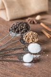 Food ingredient for cooking on a wooden board. Measuring spoons Royalty Free Stock Images