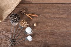 Food ingredient for cooking on a wooden board. Measuring spoons Stock Photos