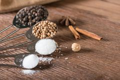 Food ingredient for cooking on a wooden board. Measuring spoons Royalty Free Stock Photo