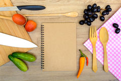 Food ingredient and kitchenware with notebook Stock Images