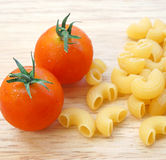 Food ingredient, tomatoes and macaroni Stock Photo