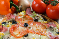 Food ingredients. A pizza and some ingredients stock images