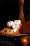 Food ingredients. Onion, garlic, meat and pepper stake Stock Image