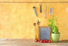 Food ingredients. Black board, kitchen utensils,cooking concept Stock Image