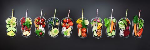 Food ingredients for blending smoothie or juice on painted glass over black chalkboard. Top view with copy space stock image