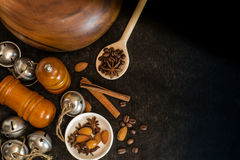 Food ingredients for cooking. Star anise, cinnamon sticks, almonds on a black background Stock Images