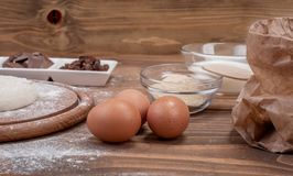 Food ingredients for dough a wooden kitchen board. Cake recipies Royalty Free Stock Image