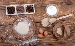 Food ingredients for dough a wooden kitchen board. Cake recipies Stock Image