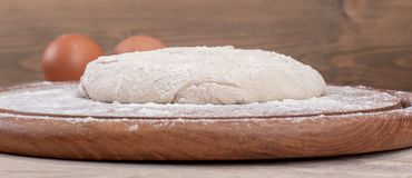 Food ingredients for dough a wooden kitchen board. Cake recipies Stock Photography
