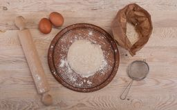 Food ingredients for dough a wooden kitchen board. Cake recipies Royalty Free Stock Photography