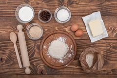Food ingredients for dough a wooden kitchen board. Cake recipies Royalty Free Stock Photo