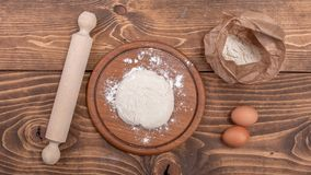 Food ingredients for dough a wooden kitchen board. Cake recipies Stock Photos