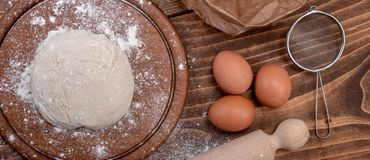 Food ingredients for dough a wooden kitchen board. Cake recipies Royalty Free Stock Images