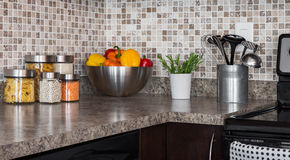 Food ingredients and herbs on kitchen countertop stock photo
