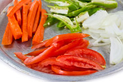 Food Ingredients. Including Sliced Tomato, Carrot, Onion and Green Chili on Stainless Plate Stock Photo