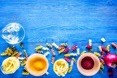 Food ingredients for Italian pasta on blue wooden desk backgroun. D top view copyspace Royalty Free Stock Image
