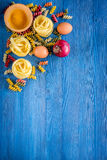 Food ingredients for Italian pasta on blue wooden desk background top view copyspace.  Stock Image