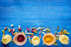 Food ingredients for Italian pasta on blue wooden desk background top view copyspace.  Royalty Free Stock Photography