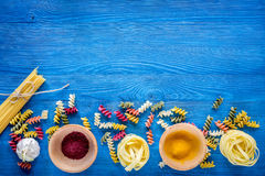 Food ingredients for Italian pasta on blue wooden desk background top view copyspace.  Stock Photography