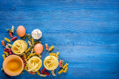 Food ingredients for Italian pasta on blue wooden desk background top view copyspace.  Stock Images