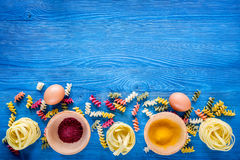 Food ingredients for Italian pasta on blue wooden desk background top view copyspace.  Royalty Free Stock Photos