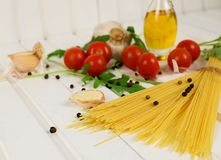 Food ingredients for Italian spaghetti onwhite wooden background with much copy space of your project. Food ingredients for Italian spaghetti on white wooden Stock Photo