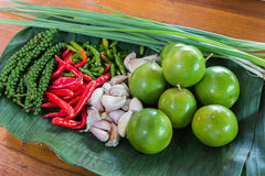 Food ingredients. Lemon, chilli peppers, Garlic, Green onion, Fresh green pepper (Piper Nigrum Stock Photo