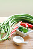food ingredients of long beans and limes Royalty Free Stock Photos