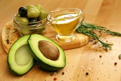 Free Food Ingredients. Olive Oil With Olives And Avocado On Table Royalty Free Stock Image - 111477566