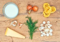 Food ingredients for pasta. Food ingredients for pasta with mushrooms Royalty Free Stock Image