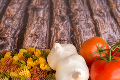 Food Ingredients for pasta on a wood background. Royalty Free Stock Image