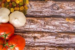 Food Ingredients for pasta on a wood background. Stock Photography
