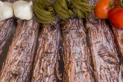 Food Ingredients for pasta on a wood background. Royalty Free Stock Photos