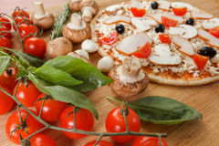 Food ingredients for pizza on table close up Royalty Free Stock Photo