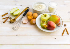 Food ingredients for the preparation apple pie. On a white wooden background royalty free stock images