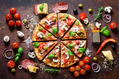 Food ingredients and spices for cooking delicious italian pizza. Mushrooms, tomatoes, cheese, onion, oil, pepper, salt royalty free stock photos