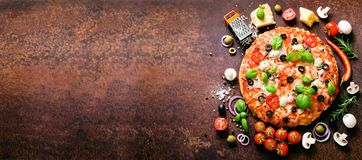 Food ingredients and spices for cooking delicious italian pizza. Mushrooms, tomatoes, cheese, onion, oil, pepper, salt royalty free stock images