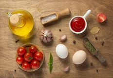 Food ingredients and spices at wooden table royalty free stock photos