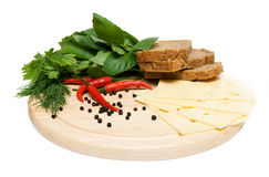 Food ingridients. Cheese, bread and greens on cutting board isolated on white background Stock Photo