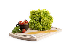 Food ingridients on wooden cutting board.  stock images