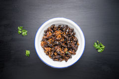 Food insect, Fried crickets in iron bowl on wooden table Royalty Free Stock Photography