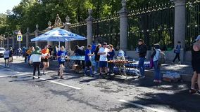 Food item at the St. Petersburg marathon. Tired runners take drinks and a snack at a long distance. Volunteers handing out drinks.  stock video footage