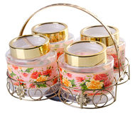 Food jars with printed flowers in rack Royalty Free Stock Photography