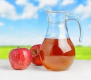 Jug of apple juice  Royalty Free Stock Photos