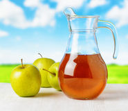 Jug of apple juice  Royalty Free Stock Photography