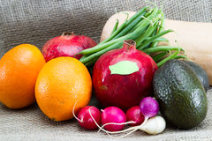 Food labeling concept. Fresh fruits and vegetables for a concept of labeling gmo vrs organic foods Stock Photography